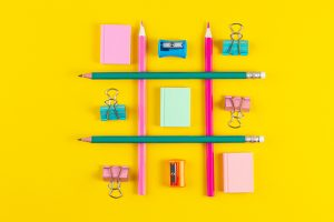 hashtag sign from crossed colorful pencils on yellow background social media and creativity concepts